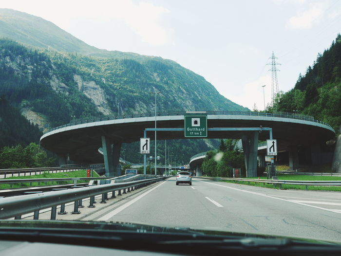 Transportation Car Road Highway Bridge - Man Made Structure Car Interior No People Day Land Vehicle Architecture Built Structure The Way Forward Road Sign Gotthard Tourist Life On The Road On The Way Gotthardpass Your Ticket To Europe
