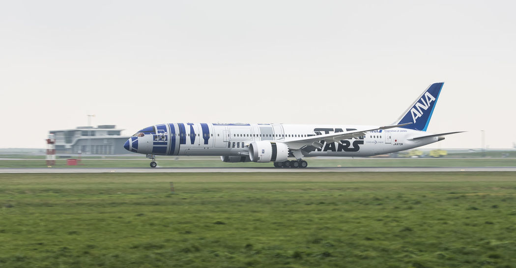 ANA Boeing 787 Dreamliner Star Wars edition Air Vehicle Airplane Airport Runway Aviation Boeing 787 Clear Sky Day Dreamliner Flying Landing Landing - Touching Down Outdoors Sky Star Wars Tourism Transportation