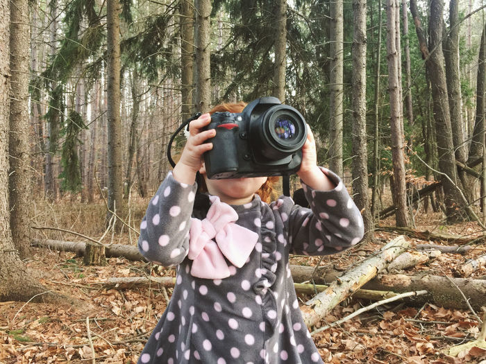 Girl Photographing In Forest