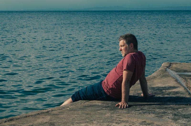 Depressed man on sea shore