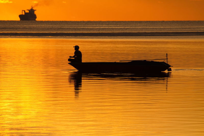 A fisherman and his life Amazing View Beauty In Nature Boat Boy Day Fisherman Fisherman Boat Kanu Life Men Nature Outdoors People Real People Reflection Scenics Sea Seascape Silhouette Sky Sunset Tranquility Water Waterscapes EyeEmNewHere