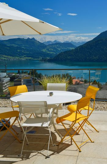 Lifestyle Luxurylifestyle  Absence Beauty In Nature Chair Day Land Luxury Mountain Mountain Range Nature No People Outdoors Relaxation Restaurant Sea Seat Setting Sky Sunlight Table Water