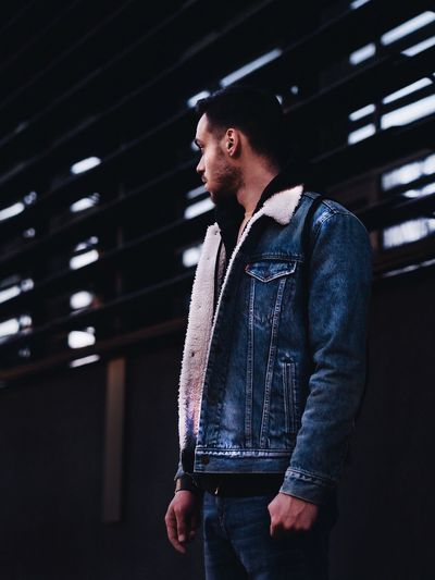 Denim Lifestyles Casual Clothing One Person Males  Young Adult Night Real People Standing Indoors  One Man Only Men Illuminated Only Men People Adult Adults Only Levis Jacket Jeans