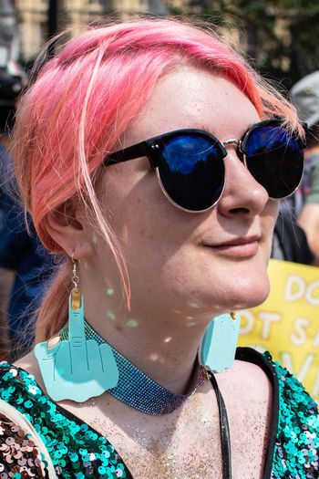 Flip the bird - Anti Trump Protest Malephotographerofthemonth LONDON❤ London Young Women Portrait Beautiful Woman Headshot Arts Culture And Entertainment Multi Colored Sunglasses Close-up Pink Hair Dyed Hair The Portraitist - 2018 EyeEm Awards The Photojournalist - 2018 EyeEm Awards