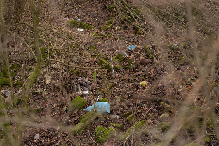 Traces Of Neglect And Dissolution Bottles Day Depression Drained Bottles Get Heavier Field Hidden Places Hideaway High Angle View Misplaced Outdoors Plastic