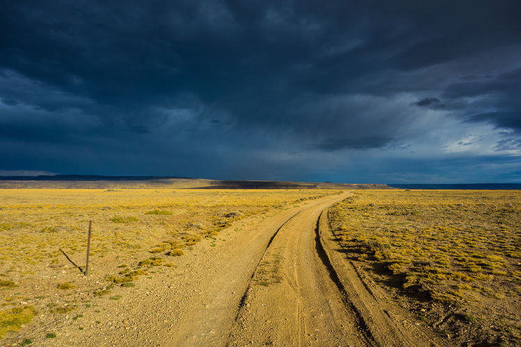 Beauty In Nature Cloud - Sky Direction Dirt Dirt Road Environment Field Horizon Over Land Land Landscape Nature No People Outdoors Road Scenics - Nature Semi-arid Sky The Way Forward Tranquility Transportation Yellow Summer Road Tripping