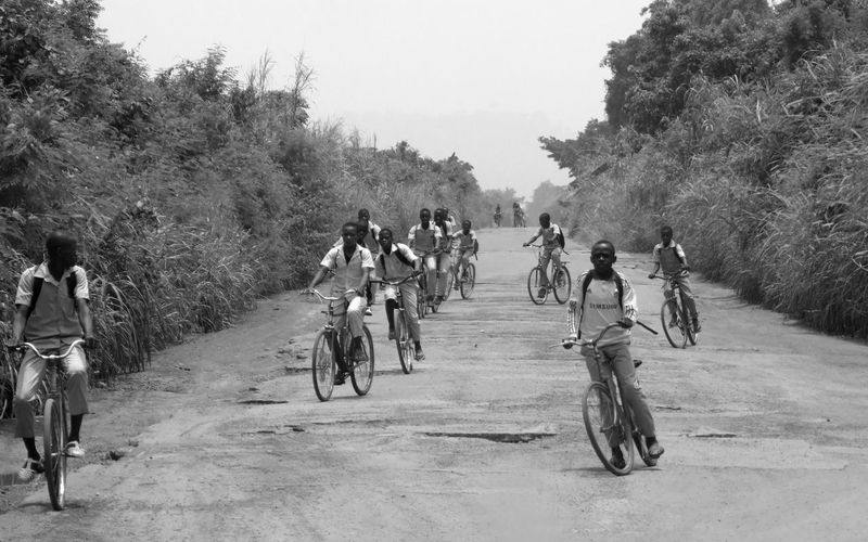 Coming from school, Kossou, Ivory Coast Bnw_bike Bnw_friday_eyeemchallenge Boys Bicycle Riding Transportation Lifestyles