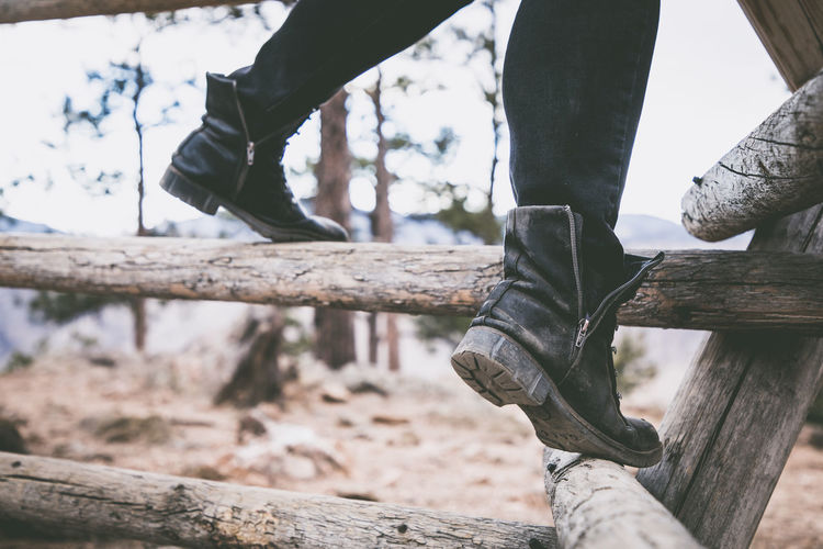 Low Section Human Leg One Person Shoe Body Part Wood - Material Human Body Part Real People Lifestyles Day Leisure Activity Men Outdoors Focus On Foreground Human Foot Jeans Wood Nature Limb Human Limb