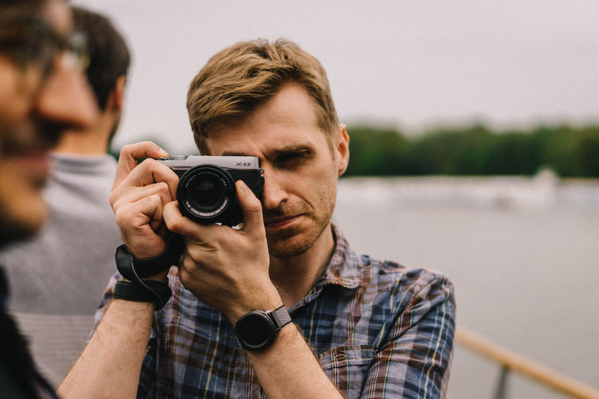 EyeEmOnABoat Team EyeEm EyeEm 2018 Eyeem Party EyeEm Team Photography Themes Camera - Photographic Equipment Photographing Technology Portrait Focus On Foreground Front View Activity One Person Casual Clothing Photographic Equipment Men Digital Camera Photographer