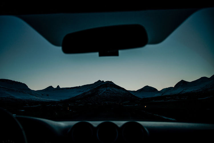 mountain ranges of Iceland Mountain Range Mountain Mountain View Hills Road Trip Car View Perspectives on Nature Perspectives Road Sunset Sunset_collection Blue Hour Windshield Mountain Car Sky Landscape The Traveler - 2018 EyeEm Awards