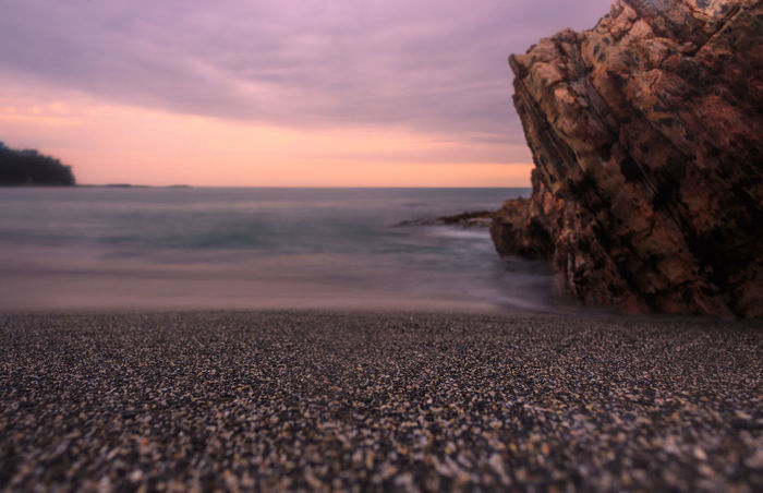 sunset over a pebble beach Ocean Australia Travel Travel Destinations Tranquility Holiday Destination Beach Sunset Sea Horizon Over Water Sand Long Exposure Wave Vacations Cloud - Sky Summer Nature Landscape No People Sky Scenics Beauty In Nature Outdoors Horizon Water Day