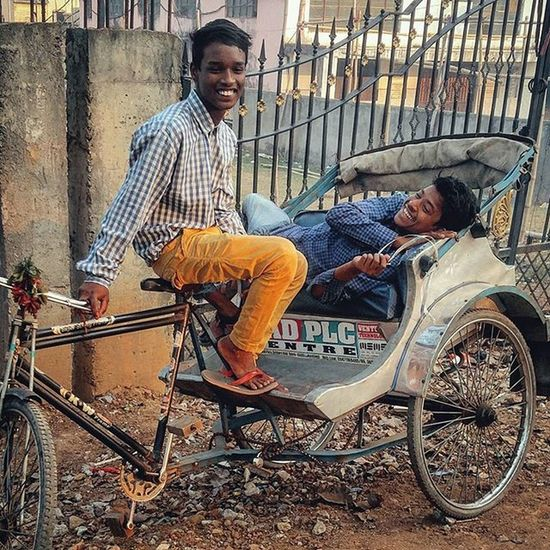Two young Indian men share a light moment as they sit on a rickshaw in Ranchi, Jharkhand, India. Communityfirst Yourshot Everydayeverywhere Dailylife Photojournalism Journalism Reportage Reportagespotlight Indiaphotoproject Onepluslife Oneplus2 Myfeatureshoot Instagram Ranchi Jharkhand India ASIA