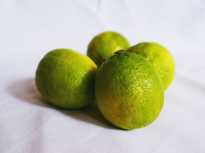 Close-up of green limes