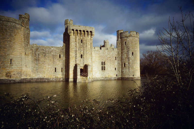 Bodiam Castle surrounded by moat Ancient Architecture Bodiam Cas Building Exterior Built Structure Castle History Medieval Moat Old Ruin Outdoors Ruined The Past