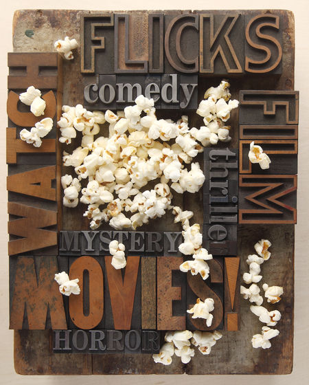 Words related to movies with popcorn Abundance Chill Time Comedy Film Flicks Fonts Food Fun Large Group Of Objects Letters Metal Type Movies No People Overhead Popcorn Recreation  Relaxing Snacks Textures Typefaces Typography Watch Wood Type Words