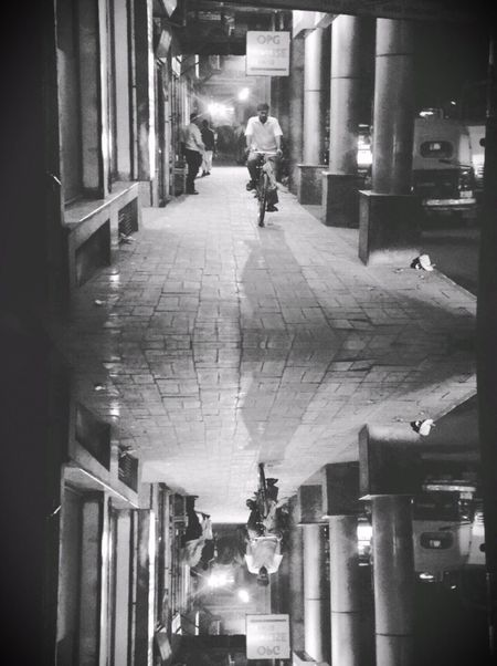 Inception in life. Built Structure Real People Architecture Illuminated One Person Men City Full Length Night Indoors  Building Exterior The Way Forward EyeEm Best Shots Vision Personal Perspective Vscocam Delhi Imagination India Inception The Street Photographer The Street Photographer - 2017 EyeEm Awards The Photojournalist - 2017 EyeEm Awards