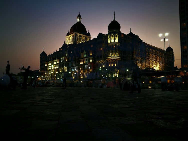 Taj Hotel in Mumbai. Located to side of the popular Gate Of India. More Mumbai photos making its way. City Architecture Sunset Business Finance And Industry Travel Destinations Ancient History Landscape Sky Night Outdoors City Gate Photography India Architecture Street Gate Of India Taj Hotel Mumbai