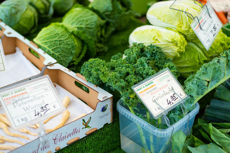 Close-up Communication Day Food Food And Drink For Sale Freshness Green Green Color Healthy Eating High Angle View Leaf Leaves Market No People Plant Part Retail  Text Vegetable Wellbeing Western Script