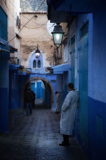 💙 Streetphotography Be.Ready Chefchauen Outdoors Day One Person Lifestyles Leisure Activity The Way Forward Full Length Men Real People Walking Building Exterior Architecture Built Structure Rear View Blue Morocco Be. Ready. The Street Photographer - 2018 EyeEm Awards The Art Of Street Photography