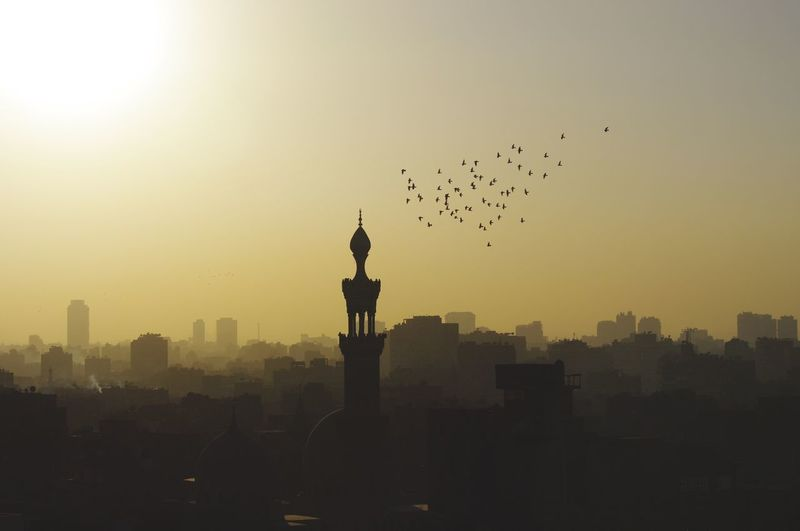 Silhouette Mosque And Cityscape Against Sky