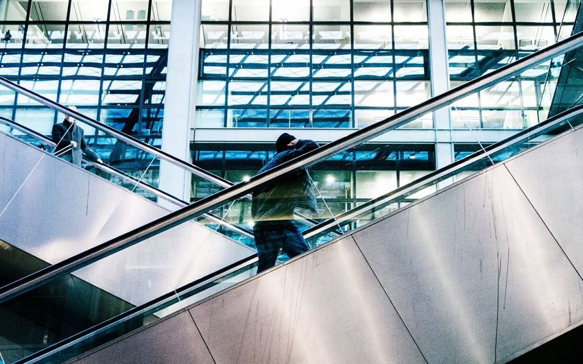 Esculator Crossing Urban Geometry Urbanphotography Architecture Leading Lines Interior Man Relaxed Transportation View From Below My Point Of View Stairs Stairways My Commute