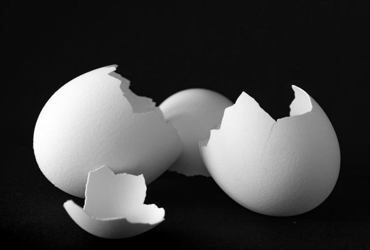 cracked eggshells Eggshell Egg Broken Indoors  Shell Cracked Studio Shot Vulnerability  Fragility Close-up Food Food And Drink No People Animal Egg White Color Freshness Healthy Eating Still Life Wellbeing Black Background Breaking Blackandwhite Bnw Bnw_collection Makro