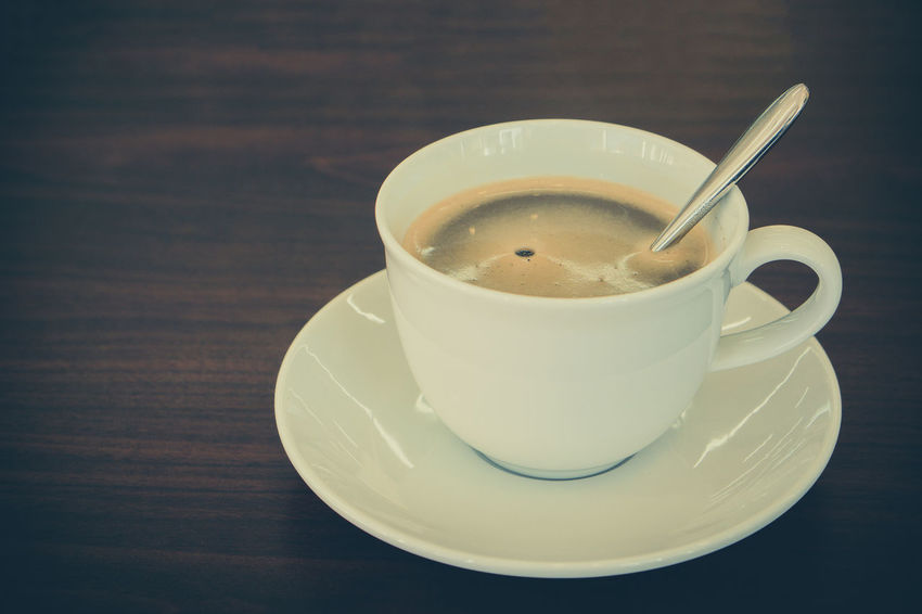 Close-up Coffee Coffee - Drink Coffee Cup Crockery Cup Drink Eating Utensil Food Food And Drink Freshness Indoors  Kitchen Utensil Mug No People Non-alcoholic Beverage Refreshment Saucer Spoon Still Life Table Tea Cup Teaspoon Temptation White Color