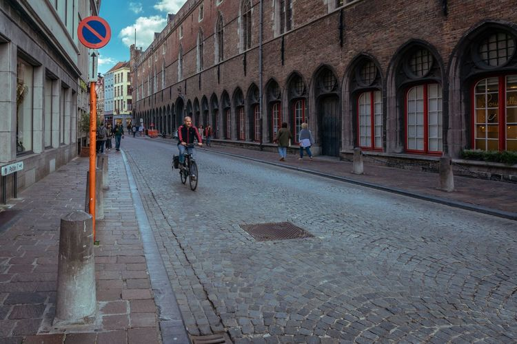 Architecture Building Exterior City Built Structure Street Real People Transportation Day Road Walking People Group Of People Adult Building