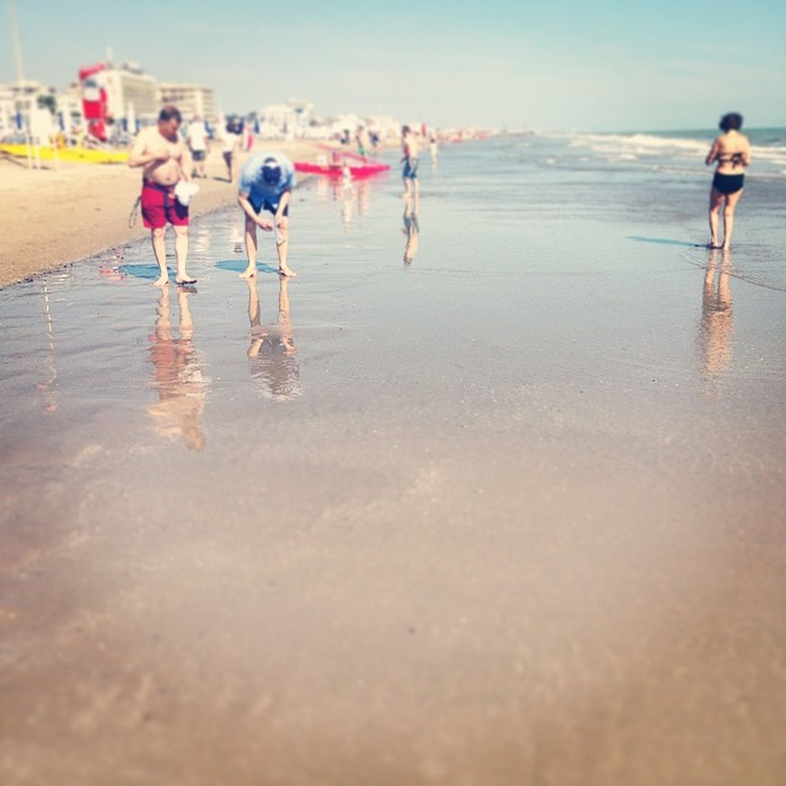 water, beach, sea, lifestyles, leisure activity, sand, shore, vacations, walking, full length, wave, person, wet, enjoyment, standing, men, weekend activities, girls