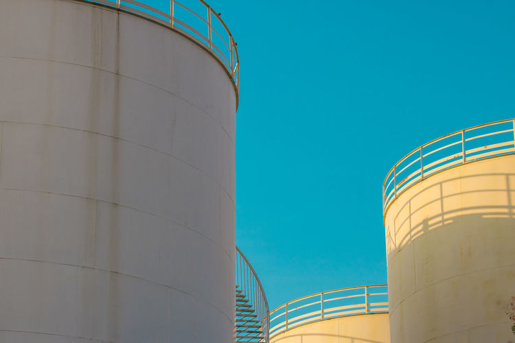Fuel And Power Generation Storage Tank Factory Copy Space Industry Architecture Storage Compartment Sky Fuel Storage Tank Silo Building Exterior No People Nature Low Angle View Built Structure Day Clear Sky Oil Industry Refinery Outdoors Chemical Plant