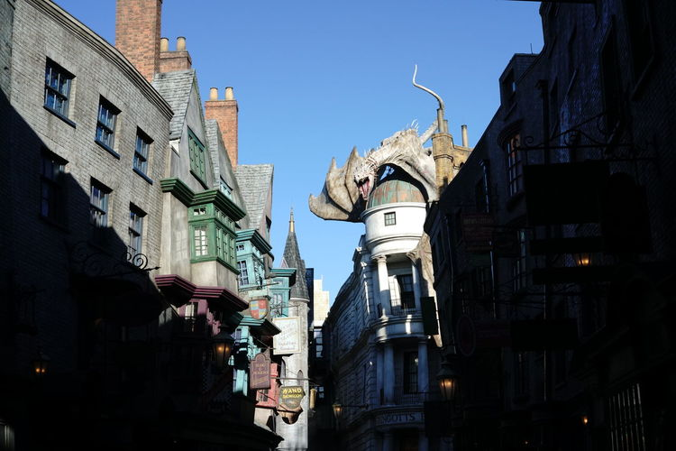 Building Exterior Architecture Built Structure City Building Sky Low Angle View Nature Residential District Day No People Outdoors Religion Clear Sky Spirituality Sunlight Belief Place Of Worship Travel Destinations Apartment Diagon Alley Harry Potter Gringotts Dragon Gringotts