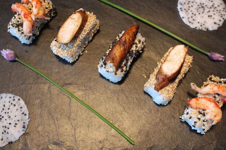 High angle view of sushi on slate