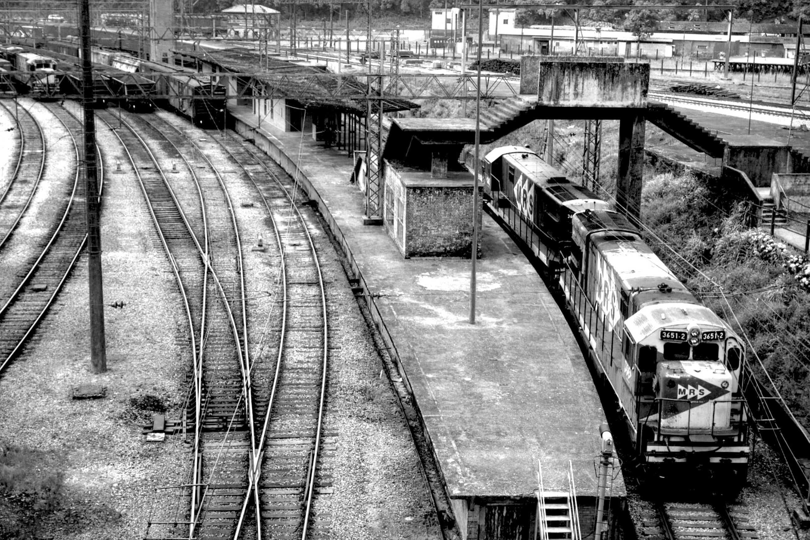 built structure, architecture, transportation, high angle view, building exterior, railroad track, the way forward, rail transportation, diminishing perspective, vanishing point, connection, railing, incidental people, city, mode of transport, day, bridge - man made structure, outdoors, canal, public transportation