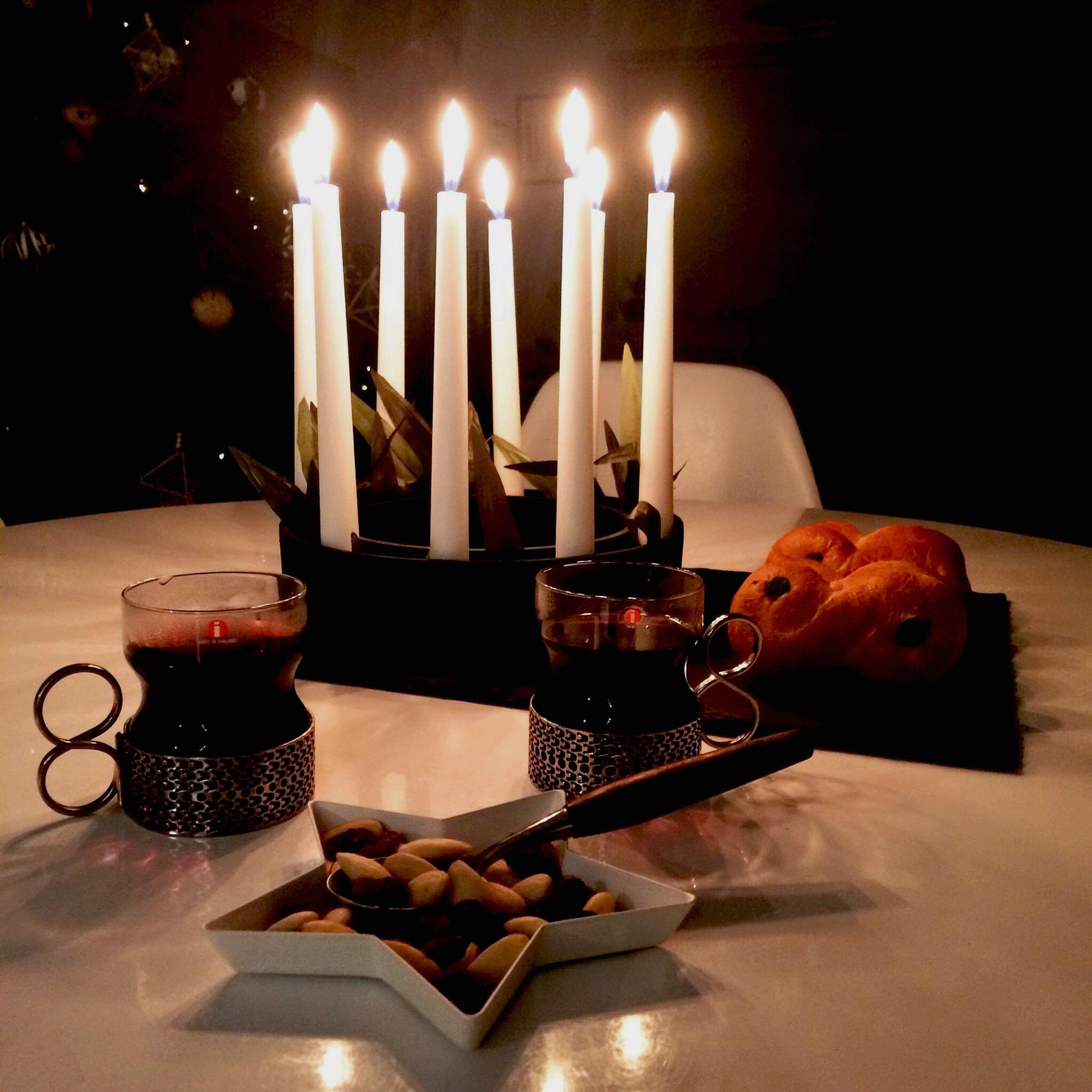 candle, flame, burning, celebration, human hand, food and drink, indoors, table, birthday cake, close-up, illuminated, birthday candles, black background, freshness