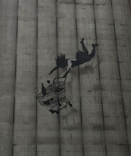 Falling shopper, Banksy Mural Graffiti Art Graffiti Concrete Modernism Shopping Trolley Banksyart Banksy Wall - Building Feature Day No People Architecture Built Structure Art And Craft Outdoors Building Exterior