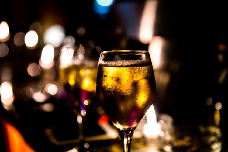 Close-up of wine in glass at bar