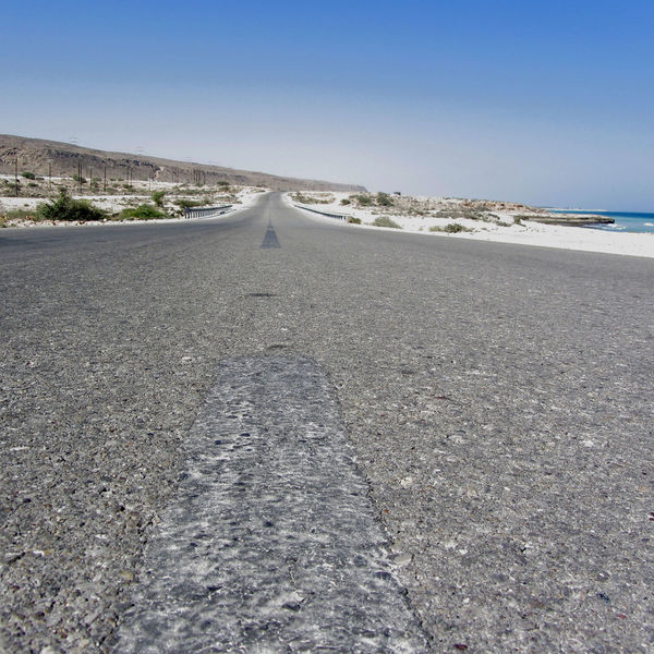 On the way from Sur to Muscat, Oman. Arabian Sea Asphalt Road Beach Beachphotography Beauty In Nature Clear Sky Day Landscape Nature No People Oman Outdoors Road Roadtrip Scenics Sky The Way Forward Tranquil Scene Tranquility White Sand Beach