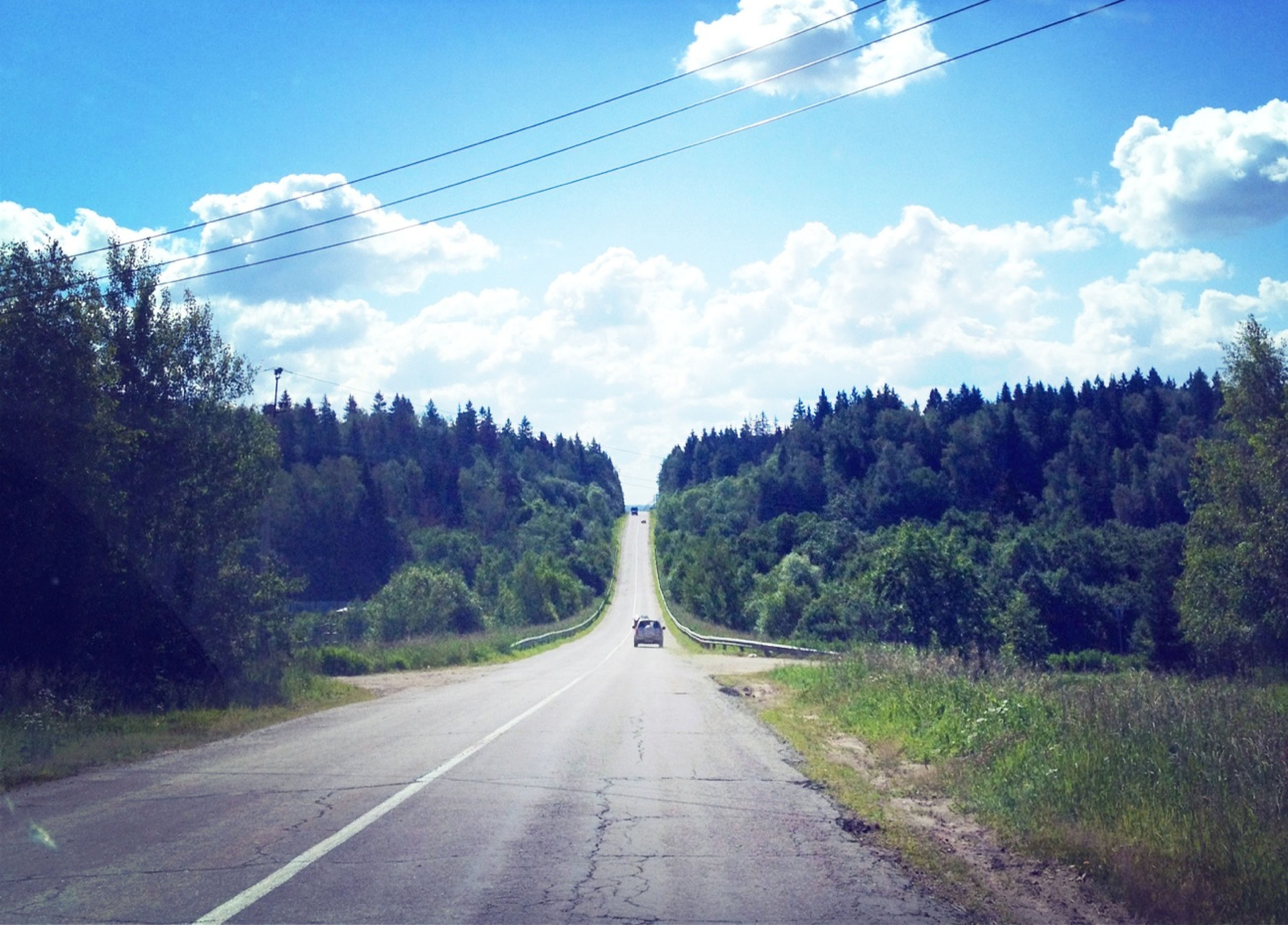 transportation, the way forward, road, tree, diminishing perspective, sky, country road, vanishing point, power line, electricity pylon, mountain, landscape, road marking, tranquility, tranquil scene, nature, blue, countryside, day, scenics