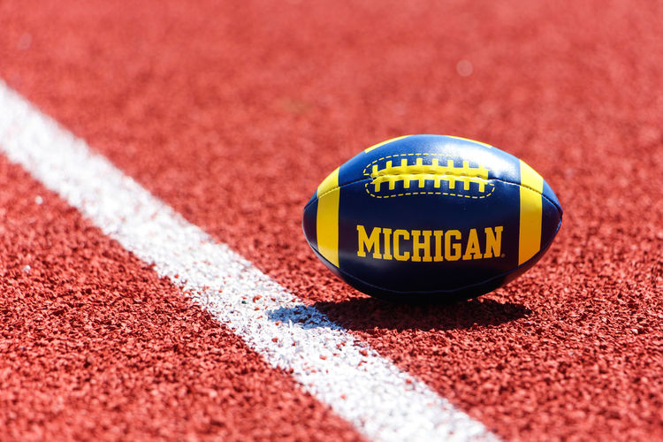 American Football Ball Capital Letter Circle The Color Of Sport Communication Geometric Shape Guidance Indoors  Love Michigan Number Playing Rugby Red Rugby Rugby TIME RugbyIsLife Rugbyworldcup2015 Selective Focus Single Object Sport Sports Photography Text Warning Sign Western Script