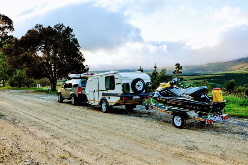 Doing it all on the journey Transportation Outdoors No People Rural Scene Cloud - Sky Day Sky Tree Nature Caravan Land Rover Trailer Kayak South Africa Let's Go. Together. Sommergefühle
