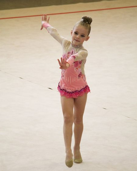 Athlete Ballet Beauty Blond Hair Cheerful Child Childhood Children Only Day Elementary Age Fun Girls Gym Gymnastics Happiness Jumping Motion One Girl Only One Person People Performance Princess Rhythmic Gymnastics Smiling Vertical