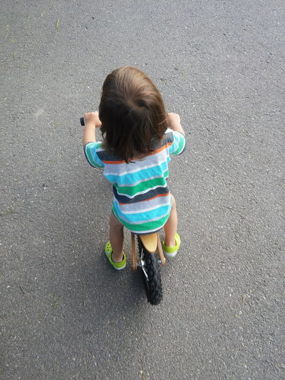 little boy riding his bike. Bicicleta, Bicycle Boys Camicleta Casual Clothing Child Childhood Crocks Cute Elementary Age Enjoyment Fun Innocence Kid Riding Bike Lifestyles Multi Colored Outdoors