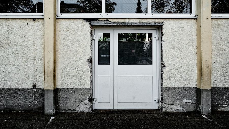 Urban Perspectives Street Photography Closed Architectural Detail Building Exterior Architecture Built Structure Entrance Building Door No People Day House Window Outdoors Wood - Material Glass - Material Security Plant Wall - Building Feature Old The Way Forward