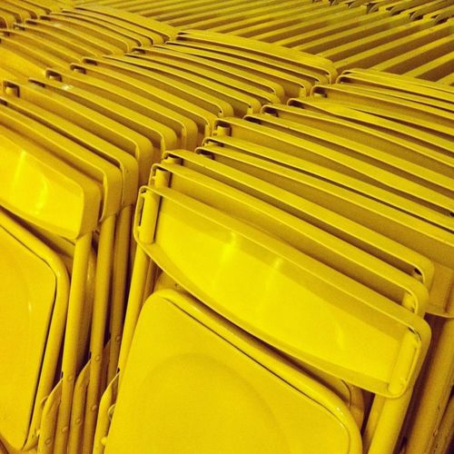 High angle view of yellow folding chairs