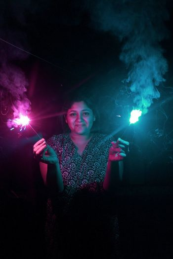 Pink and blue autumn in India Diwali Autumn Pink Color Blue Woman Portrait Illuminated Nightlife Black Background Firework - Man Made Object Sparkler Firework Long Exposure Autumn Mood The Modern Professional Holiday Moments