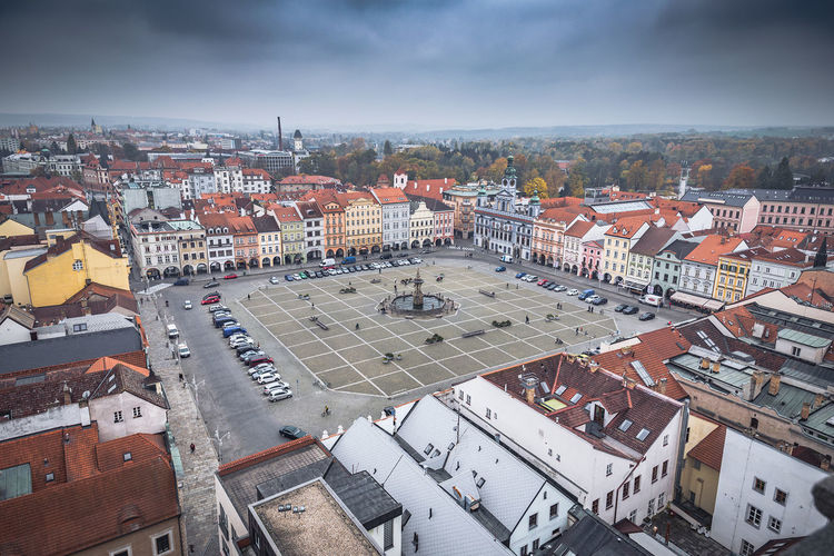 Town square against cloudy sky