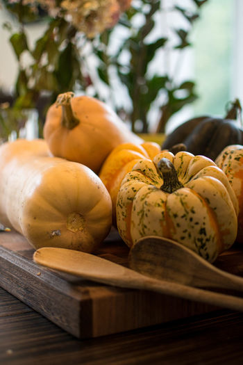 Close-up of pumpkins on table at market