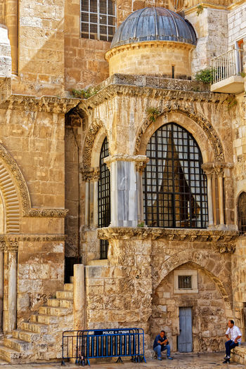 Men sitting by church of the holy sepulchre
