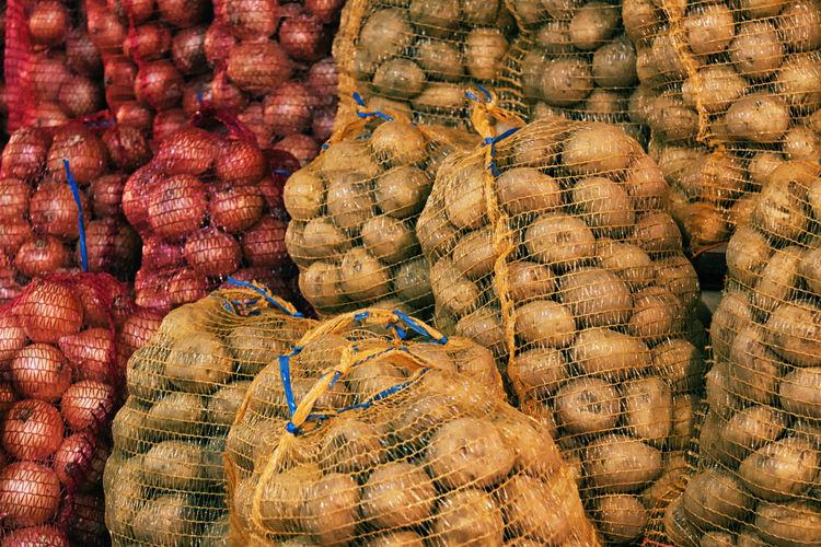 Stack of potato and onion sacks