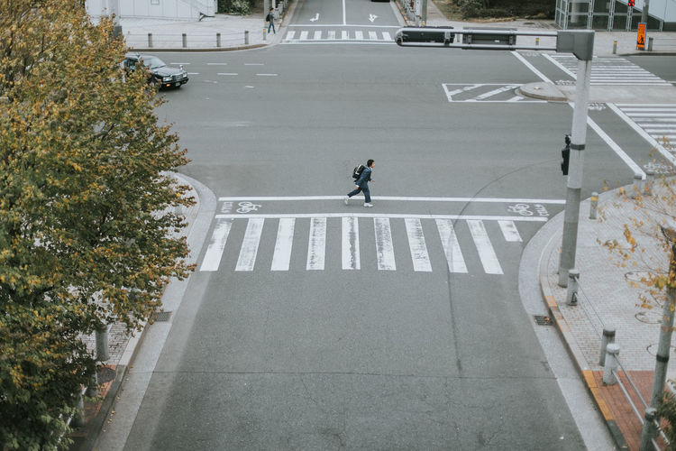 High angle view of boy running on road